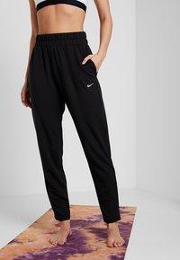 Nike Performance - FLOW PANT - Træningsbukser - black/white - 0
