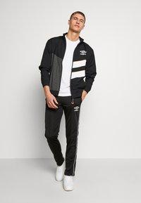 Umbro - DIAMOND CUT TRACK JACKET - Training jacket - black/brilliant white - 1