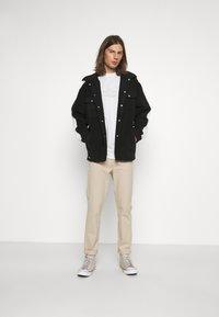 WRSTBHVR - GATY UNISEX - Fleece jacket - black - 1