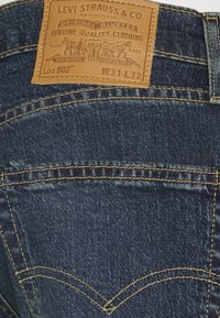 Levi's® - 502™ REGULAR TAPER - Jeans Tapered Fit - dark indigo/worn in - 6