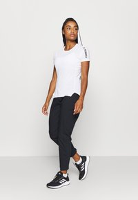 adidas Performance - HIKEREL PANTS - Pantalones - black - 1