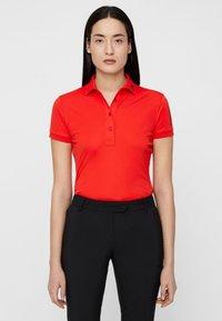 J.LINDEBERG - TOUR TECH - Sports shirt - light red - 0