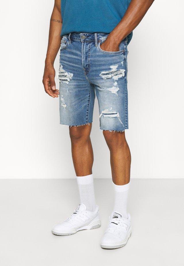 CUT OFF HEM - Denim shorts - bright blue
