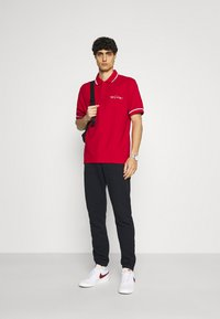 Tommy Hilfiger - SIGNATURE CASUAL - Polo shirt - primary red - 1