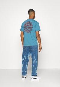 WAWWA - HARMONIA UNISEX - Print T-shirt - sky blue - 2
