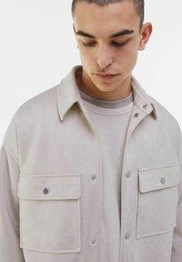 Bershka - Faux leather jacket - stone - 3