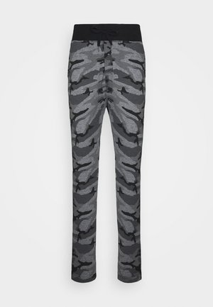 PAUL COMBAT - Tracksuit bottoms - black