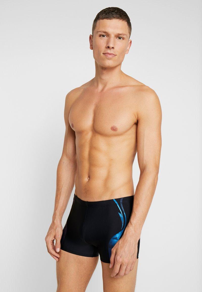 Arena - SLINKY SHORT - Swimming trunks - black