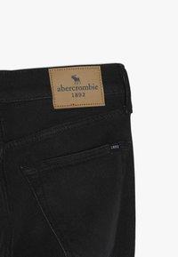Abercrombie & Fitch - SKINNY - Slim fit jeans - black - 4