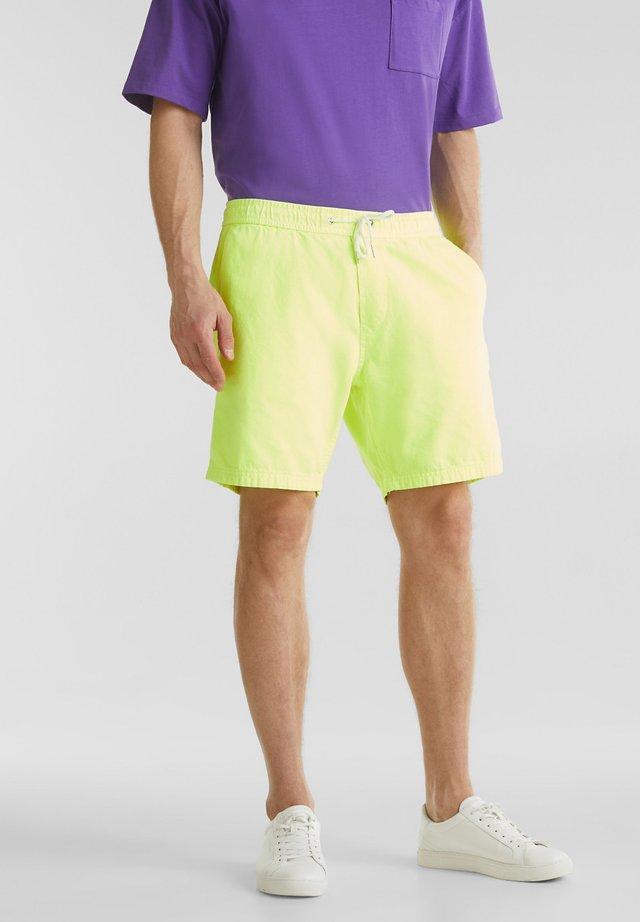 MIT GUMMIZUGBUND - Shorts - bright yellow