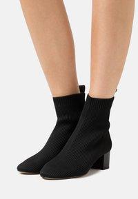 Kurt Geiger London - ELMER BOOT - Classic ankle boots - black - 0