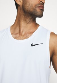 Nike Performance - TANK DRY - Sports shirt - white/black - 4