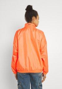 Nike Sportswear - Veste coupe-vent - atomic orange/black - 2