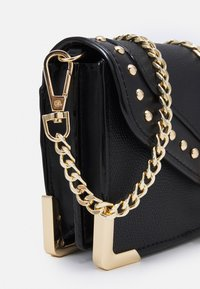 ALDO - Across body bag - jet black/light gold-coloured - 3