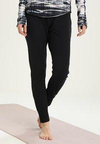 Free People - SUNNY SKINNY - Pantalones deportivos - black - 0