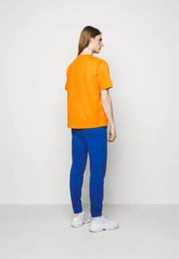 Holzweiler - HANGER TEE - Basic T-shirt - orange - 2