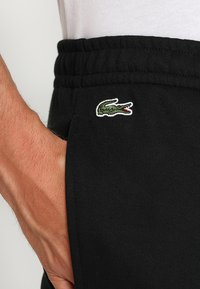 Lacoste Sport - Tracksuit bottoms - black - 5