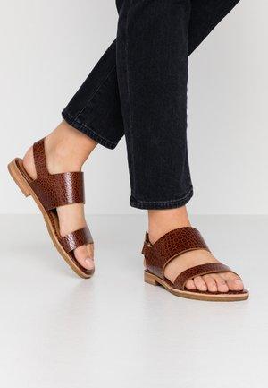 Sandaalit nilkkaremmillä - cognac/yango