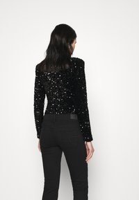 Good American - STRETCH SEQUINS - Long sleeved top - black - 2