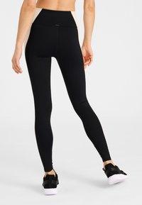 Daquïni - ALIGN LEGGINGS - Leggings - black - 2