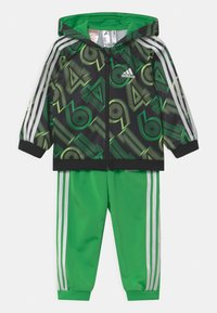 adidas Performance - SHINY SET UNISEX - Tuta - green, black - 0