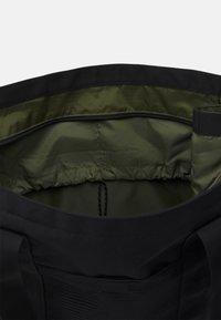 adidas Performance - TOTE - Tote bag - black/wild pine - 2
