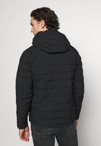 Abercrombie & Fitch - PUFFER JACKET - Light jacket - black - 2