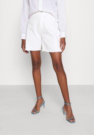 LONGLINE - Denim shorts - white
