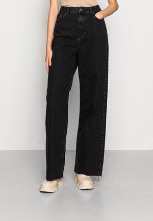 WIDE LEG - Flared Jeans - washed black