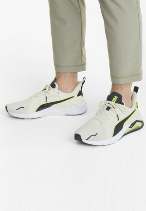X FIRST MILE LQDCELL METHOD MAND - Sneakers - eggnog yellow alert-black