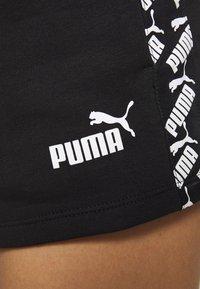 Puma - AMPLIFIED - Sports shorts - black - 6