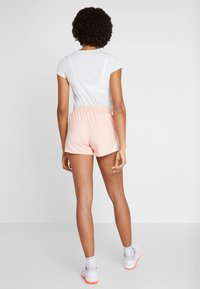 Under Armour - FLY BY SHORT - Sports shorts - calla/peach frost - 2
