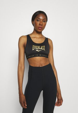 Light support sports bra - noir/nuggets