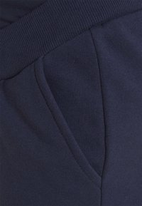 Anna Field MAMA - Tracksuit bottoms - dark blue - 5