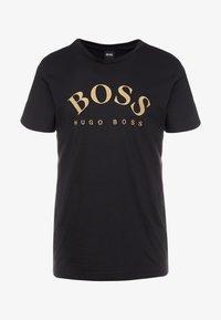 BOSS - T-shirt med print - black/gold - 3