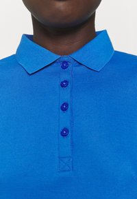 Calvin Klein Golf - PERFORMANCE - Polo shirt - yale blue - 5
