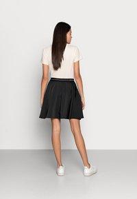 Calvin Klein Jeans - LOGO ELASTIC SKIRT - Mini skirt - black - 2