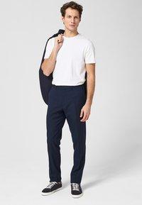 s.Oliver BLACK LABEL - Trousers - dark blue - 1