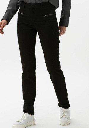 STYLE SHAKIRA - Trousers - black