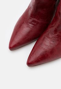 Iro - COTOPA - Classic ankle boots - red - 6