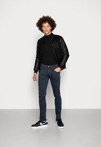 Replay - ANBASS HYPERFLEX - Slim fit jeans - blue - 1