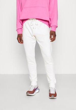 BASIC SLIM FIT JOGGERS - Pantalon de survêtement - off white