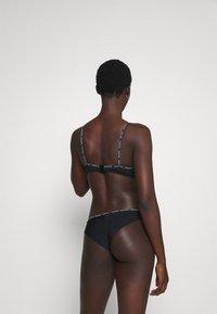 Calvin Klein Swimwear - CORE LOGO TAPEBRAZILIAN - Bikini bottoms - black - 2