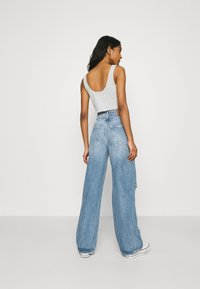 Gina Tricot - IDUN WIDE - Flared jeans - blue destroy - 2