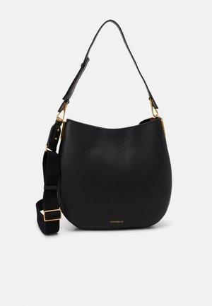 ARPEGE HOBO BAG - Handbag - noir/caramel