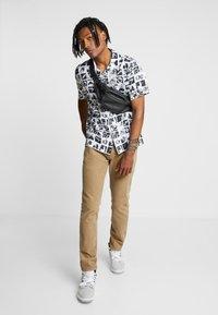 Levi's® - 511™ SLIM FIT - Trousers - beige - 1