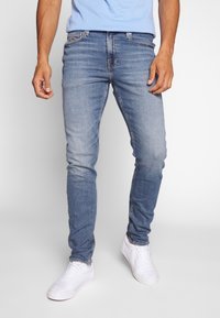 Calvin Klein Jeans - SLIM TAPER - Slim fit jeans - dark blue - 0