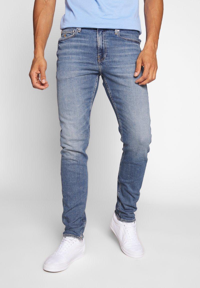 Calvin Klein Jeans - SLIM TAPER - Slim fit jeans - dark blue