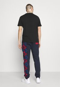 Carlo Colucci - UNISEX - Tracksuit bottoms - navy - 2