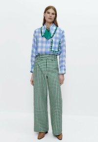 Uterqüe - Button-down blouse - blue denim - 1